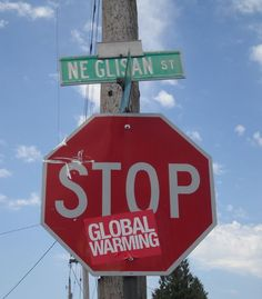 """Stop Global Warming"" - stop sign sticker graffiti"
