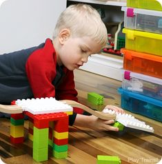 Creative building play combining DUPLO and wooden train tracks with Dreamup Toys Wooden Railway Block Platforms..