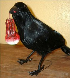 Halloween prop bird eating bloody body part