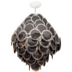 Black Murano Disc Chandelier | From a unique collection of antique and modern chandeliers and pendants  at https://www.1stdibs.com/furniture/lighting/chandeliers-pendant-lights/