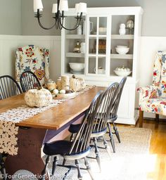 This fall dining room is so beautiful. Love the pops of color from the wing back chairs!