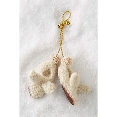 Anthropologie Slippers Ornament ($6) ❤ liked on Polyvore featuring home, home decor, holiday decorations, ivory, anthropologie home decor and anthropologie