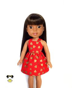 Spaghetti strap and gold hearts on this doll dress, perfect for Wellie Wishers! The dress features a gold hearts print on a red background with spaghetti straps and a Velcro closure. Item was handcrafted in our pet free, smoke free sewing studio. • Listing includes – Dress only to fit 14