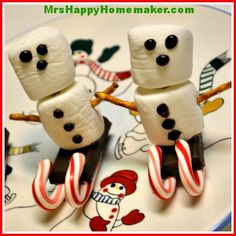 Easy Snowmen on a Candy Cane Sled Treat (Snowmen on a Stick too!)