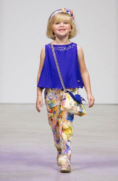 Kidswear Trends 2015 - MIAMI, FL - OCTOBER 26:  A model walkes the runway at the Pili Carerra show during petitePARADE  Kids Fashion Week, Miami October 2014 at The Moore Building on October 26, 2014 in Miami, Florida.  (Photo by John Parra/Getty Images)
