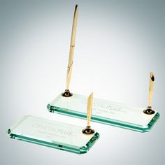 """Engraved Jade Crystal Beveled Edge Double Desk Pen Set. The Jade Glass ½"""" thick Double Pen Set features a large etch area for your name or logo. Available in double and single pen holder. Can be given as a great gift or birthday present! Gold Pens included. Measures 0.5"""" x 8"""" x 3""""."""