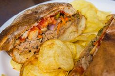 Ftira is Malta's local bread and is usually served with a dabbing of oil, tomato paste and a filling of tuna fish salad. It usually comes with salty potato chips (crisps). Around 4-5 Euro.