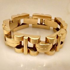 Stephen P. Kahan & Son LTD: Retro 18 Karat Yellow Gold Tank Track Bracelet