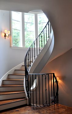 Stairs elegant curving iron railing and spindles