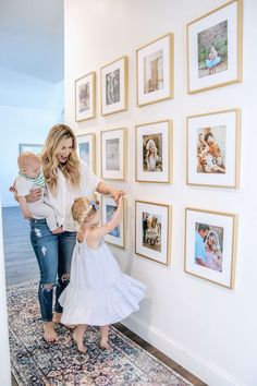 Making a House Feel Like Home: Family Picture Frame Inspiration - Frame It Easy Family Picture Collages, Family Pictures On Wall, Hallway Pictures, Stairway Photos, Display Family Photos, Family Photo Frames, Picture Frame Inspiration, Decor Inspiration, White Picture Frames