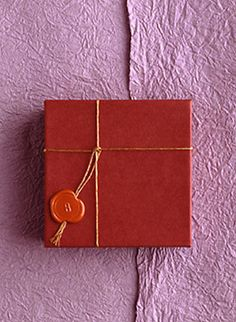 wax seal present red and pink