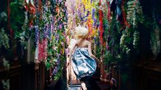 Sasha Luss running in a hall full of flowers for the Dior Addict fragrance film directed by Harmony Korine