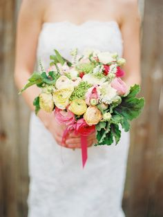 bouquet filled with ranunculus, veronica, queen's anne lace, scabiosa and scented geranium leaves