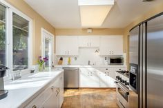 Built in cabinetry and modern appliances are spread throughout the kitchen.