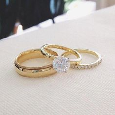 Beautiful matching yellow gold engagement and wedding rings. 4 prong, all yellow gold solitaire, round diamond with a diamond wedding band. Platinum Wedding Rings, Gold Wedding Rings, Gold Engagement Rings, Wedding Engagement, Matching Wedding Rings, Matching Rings, Bridal Rings, Womens Gold Wedding Band, Tiffany Wedding Rings