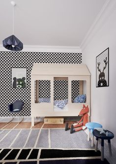 house kids bed with black and white wallpaper