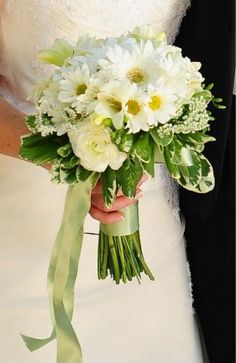 Fresh and delicate wedding flowers. The simple purity of white and green makes a nice statement.