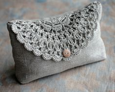 Linen clutch, pouch, purse, makeup bag -- crocheted detail closure. $35.00, via Etsy.