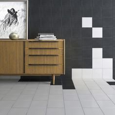 The Serenity black tiles made from quality porcelain are perfect for walls or as black floor tiles. They can be used on their own to create a modern monochrome style or if you prefer co-ordinate with the Tulip decorative tiles for a Victorian style design.
