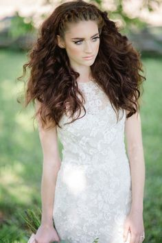 Big, voluminous curls and a crown braid:
