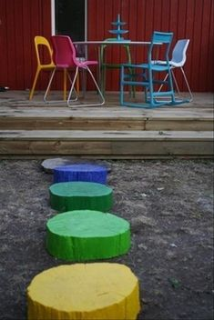 """Spray painted wood in spring colors as stepping """"stones"""""""