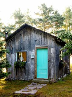 Cute little shed with bright turquoise door. stacey van berkel lifestyle photography.