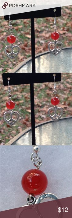 Carnelian Heart Peace Sign Earrings These lovely earrings are made with natural carnelian and silver tone heart shaped peace sign charms. The hooks are sterling silver plated.   All PeaceFrog jewelry items are handmade by me! Take a look through my boutique for more unique creations. PeaceFrog Jewelry Earrings