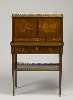 """Lady's desk """"This desk bears the stamp of Evalde, who became a master ébéniste, or maker of inlaid furniture, in 1765. He was responsible for the now lost jewel cabinet that King Louis XV of France presented to Marie-Antoinette on the occasion of her marriage to the future Louis XVI in 1770. The key to this desk bears the crown of France, indicating that the piece may have been made for a member of the royal family."""" 1770"""