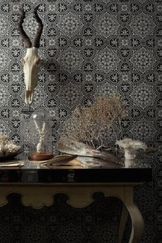 A large scale tiled effect design with finely a detailed circular motif by Cole and Son. Love this statement paper, ideal for a vintage or industrial style look.
