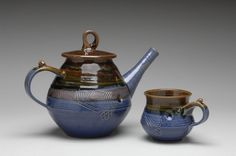 Tea pot and cup by Becky Garrity.