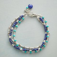 """CHANGE IT UP BRACELET--Three strands of turquoise, lapis and sterling silver beads, of varying shapes, convene to create a bracelet to go with every look. Sterling lobster clasp. USA. Exclusive. 7-3/4""""L."""