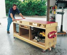 A dead-flat torsion box is the foundation of this tool stand, which fits all the tools you could need. Free DIY workbench plans within! **THIS is the workbench I need to build! Popular Woodworking, Woodworking Bench, Woodworking Shop, Woodworking Crafts, Woodworking Basics, Grizzly Woodworking, Woodworking Quotes, Woodworking Workshop, Woodworking Techniques