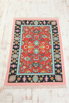 UrbanOutfitters.com > 4x6 Magic Carpet Rug - I ordered it and it's wonderful!  The size was perfect for the living room, the pink is pretty subtle, and even though it's super cheap, it doesn't feel like it.
