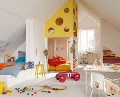 Fun room, but that little loft playhouse looks like a piece of cheese. I'd pick a different color.