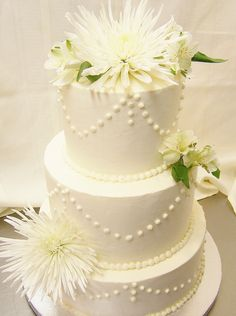 Buttercream with swags and mums by Kiss Me Cakes, Wellfleet, MA.