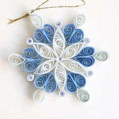 6 point blue and white quilled snowflake with silver glitter and silver diamante