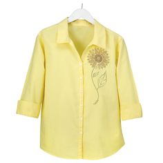Let the sun shine! Ideal for year-round wear, this 100% garment-dyed cotton shirt is stylish, comfortable and carries a UPF rating of 25+. The close woven fabric will help protect you from the sun's harmful rays. Designed with a shirt collar, three-quarter length sleeves, and button front, the bright yellow shirt features a shining metallic bead sunflower design. Machine washable. Imported. Available in adult sizes: (S-XL) $49.99 (2X) $59.99.