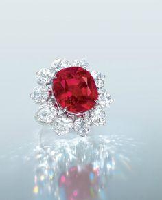 The Crimson Flame. An extrordinary 15.04 carats Burma Mogok  'Pigeon Blood Red Ruby and Diamond ring.