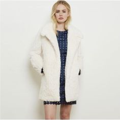 All we need in this cold weather is our faux fur Blanche coat. Available online now.