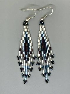 These hand-woven brick stitch bead earrings are made with high quality 3mm glass bugle and 11/0 glass seed beads. At just over 2.5 long, they shimmer gorgeously in the sunshine and, because theyre light in weight, they have great movement. Dress them up or dress them down; these fun Beaded Earrings Native, Fringe Earrings, Bead Earrings, Diy Jewelry, Beaded Jewelry, Fashion Jewelry, Jewelry Making, Jewellery, Bugle Beads