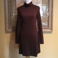 "SALE Boston Proper Brown Turtleneck Dress This is a great brown turtleneck dress from Boston Proper size XS.  It has an A Line cut at the bottom & falls just above the knee.  It's super flattering to your figure & features zippers in back of each sleeve.  It's made of a rayon/nylon/spandex blend & measures 29 1/2"" from neckline to bottom; 16"" from armpit to armpit & the sleeves are 24"" from shoulder to wrist.  Worn once it is in great condition.  Wear with brown knee high boots (like the…"