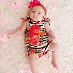 precious little baby girl rocking her pattern play floral and stripe striped romper! ready for summer! - shop our instagram at shop.row10baby.com