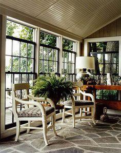 Thom Felicia sunroom with stone floor, black painted windows
