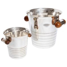Two Christofle Ice Buckets with Wood Handles   From a unique collection of…