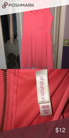 criss cross, coral sundress worn very few times, perfect for summer. Criss cross in front. super cute summer dress lined as well Dresses