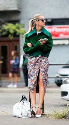 No. 1 - Natalie Joos  Between the boxy Kelly green jacket and printed, slit Max Mara skirt, this outfit is a nice way to transition to fall without resorting to gloomy colors. So, congrats, Natalie, on your first win!    Photo:  Youngjun Koo/I'M KOO