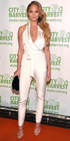 """Last Night's Look: Love It or Leave It? Vote Now!   CHRISSY TEIGEN   in a cream-colored satin jumpsuit and pale gold mules at City Harvest's Annual Gala """"An Evening of Practical Magic"""" in N.Y.C."""