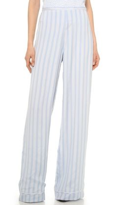 These striped silk Rochas trousers are cut in a bold, wide-leg silhouette. Piped edges lend a chic pajama-inspired feel, while the high waist lends a mod finish. Exposed side zip.