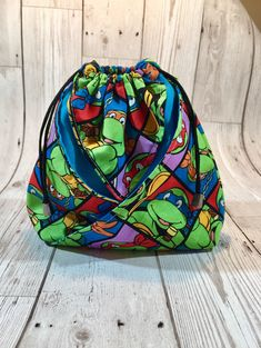 Excited to share the latest addition to my shop: Origami bag made from Ninja Turtle fabric, dice bag, cosmetics pouch, comic bag, drawstring pouch, three pocket bag, counters bag