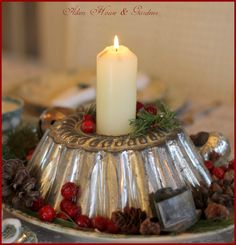 Vintage mold for a Christmas centerpiece - We have several vintage molds and mini bundt cake pans - perfect for  creating this look!  Add cranberries, a few sprigs of pine, pine cones and a tiny heart cookie cutter {we have these too!} and a single white candle.